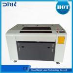 Co2 laser engraver 60w 80w 3d laser cutting 20mm acrylic mdf wood acrylic laser engraving cutting machine Manufactures