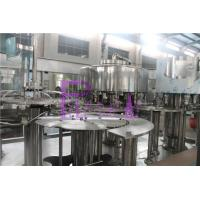 12 Heads Big Bottle Vacuum Filling Machine With Chain Feeding Conveyor Manufactures