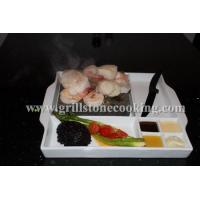 Ceramic steak stone cooking meat on a hot rock lava stone Manufactures
