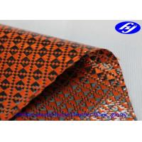 Orange Polyurethane Leather Fabric Glossy Carbon Kevlar Hybrid For Sports Equipments Manufactures