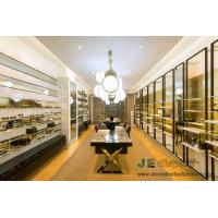 China Eyeglass display showcase design by high metal racks with mirror panel and Selling counters in glass cube on sale