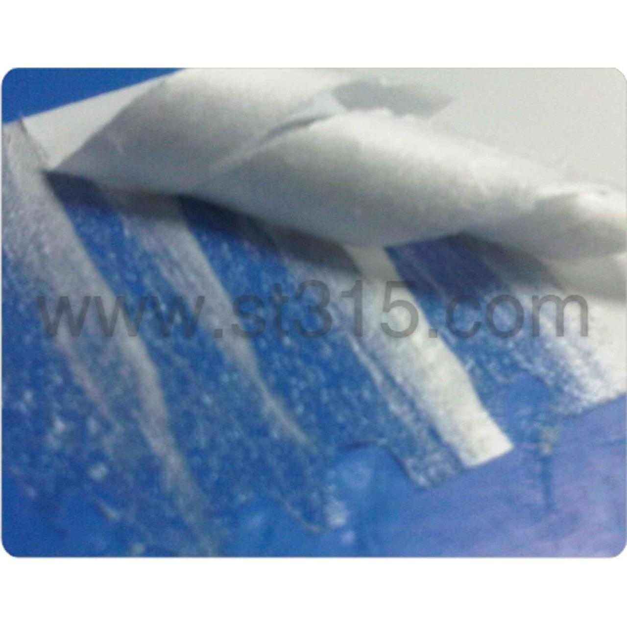 Co-extruded friable material